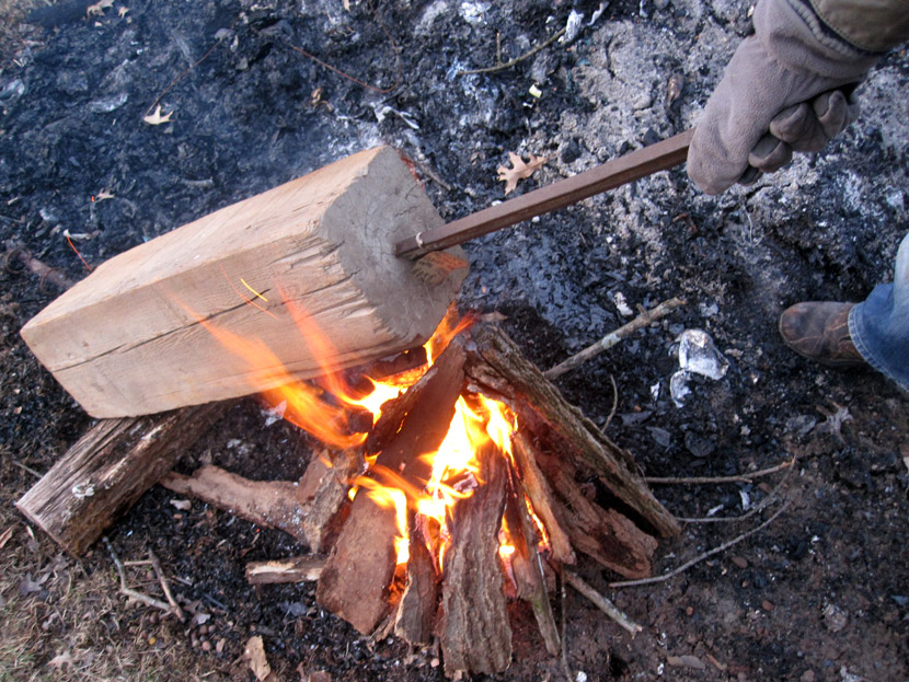 The wood was held over a fire to burn the lower half