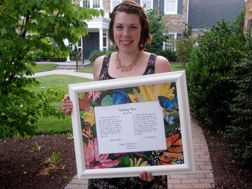 Kate holding the finished, framed wedding vows